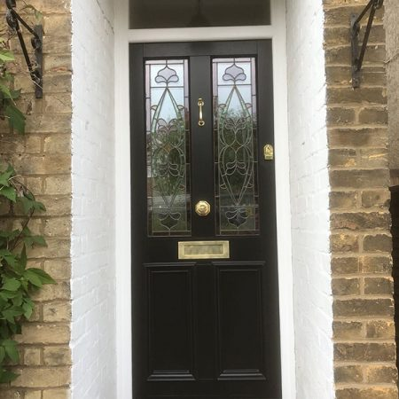 Black timber door with small porch