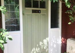 Pale green timber door