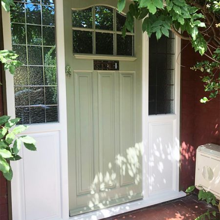Pale green timber door