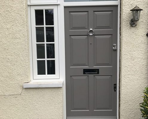 Grey timber door with glazing