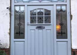 Pale blue timber door with glazing