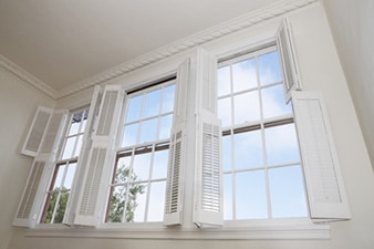 White plantation style window shutters