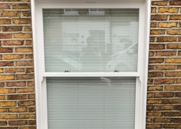 White timber sash window