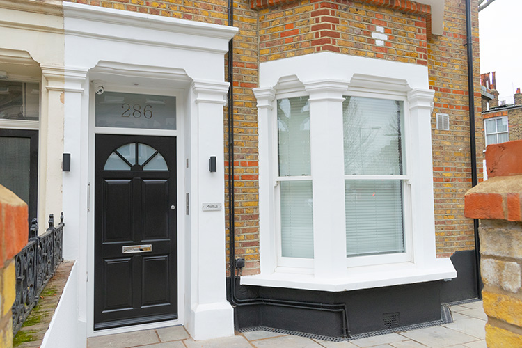 Black timber front door and white timber windows