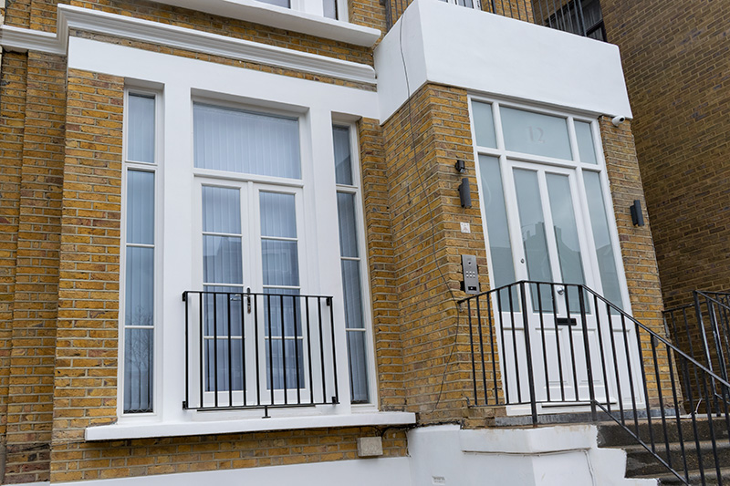 White timber front door and French doors