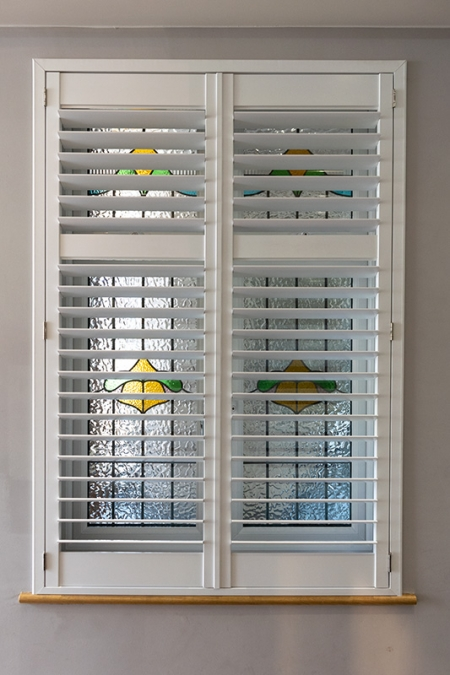 White bespoke window shutters