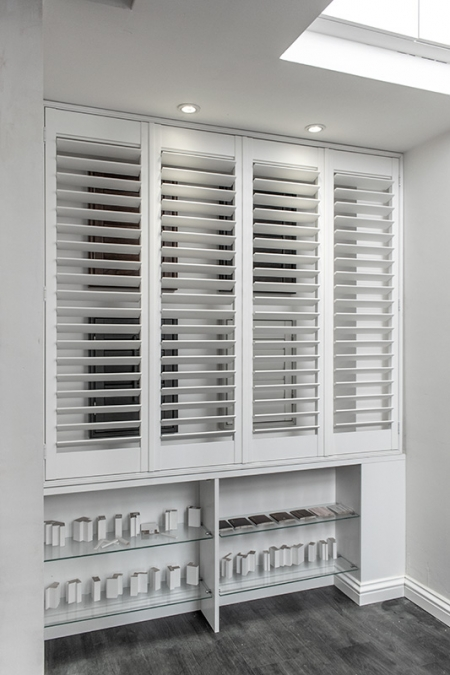 Display of white window shutters