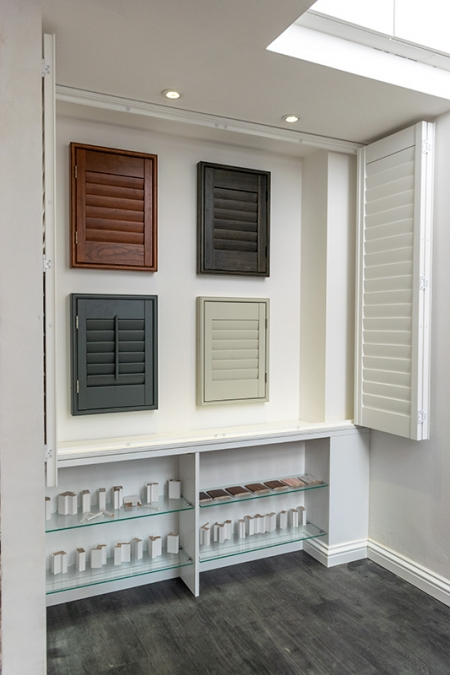 Different coloured window shutters
