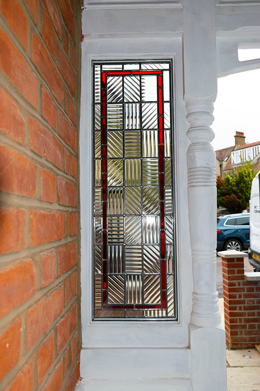 White stained glass timber window