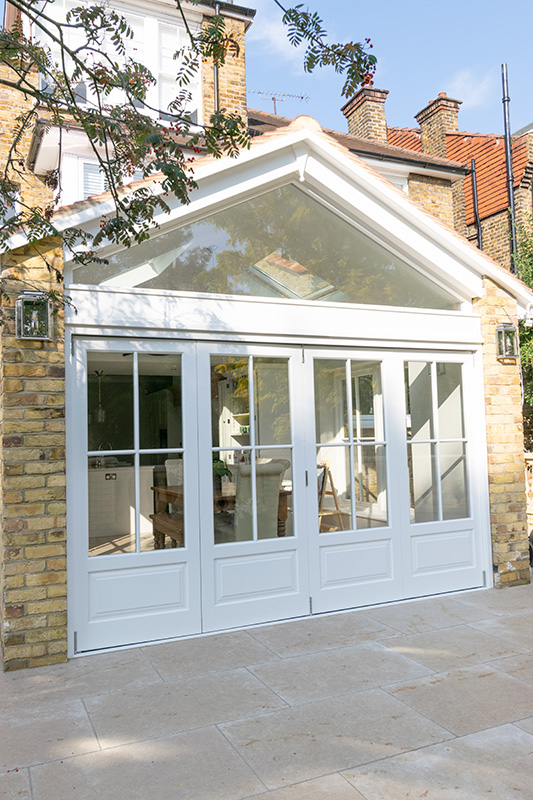 Exterior view of white timber bifold doors