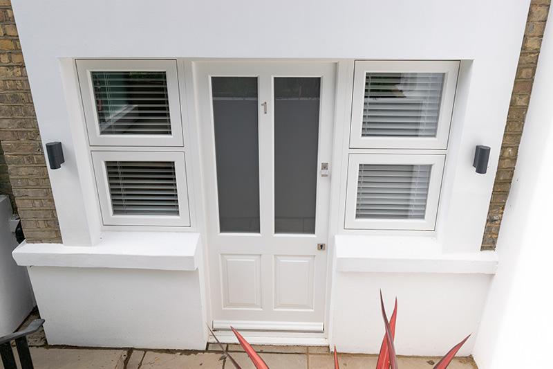 Basement timber door and window installation