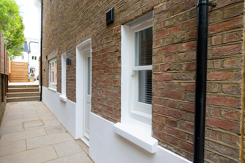 Side view of timber door and windows installation