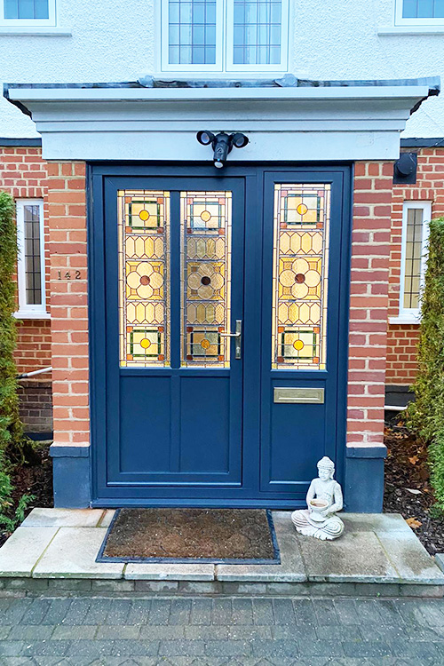 Composite door with stained glass