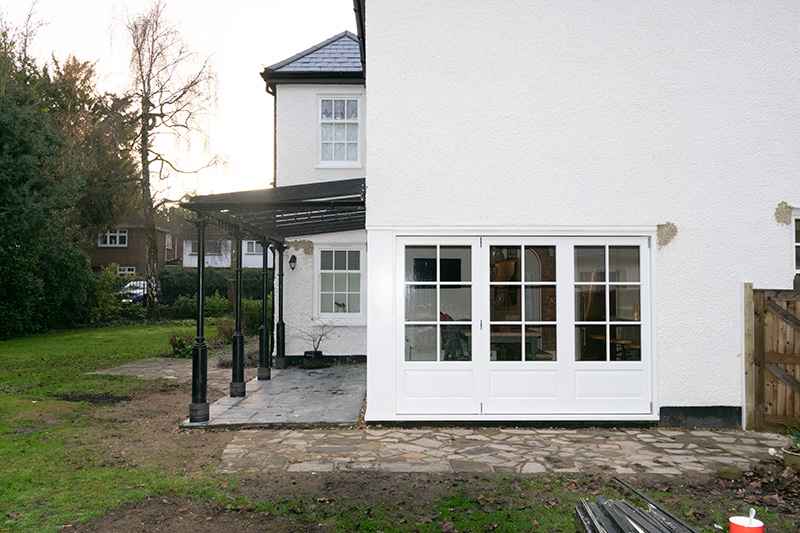 Exterior view of timber white bifold doors
