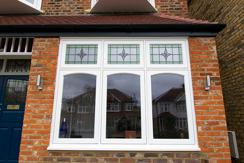 Timber window with stained glass fan lights